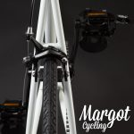 Retro bicicletta fissa telaio bianco luminoso al buio
