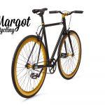 City bike a scatto fisso nera con cerchi giallo oro